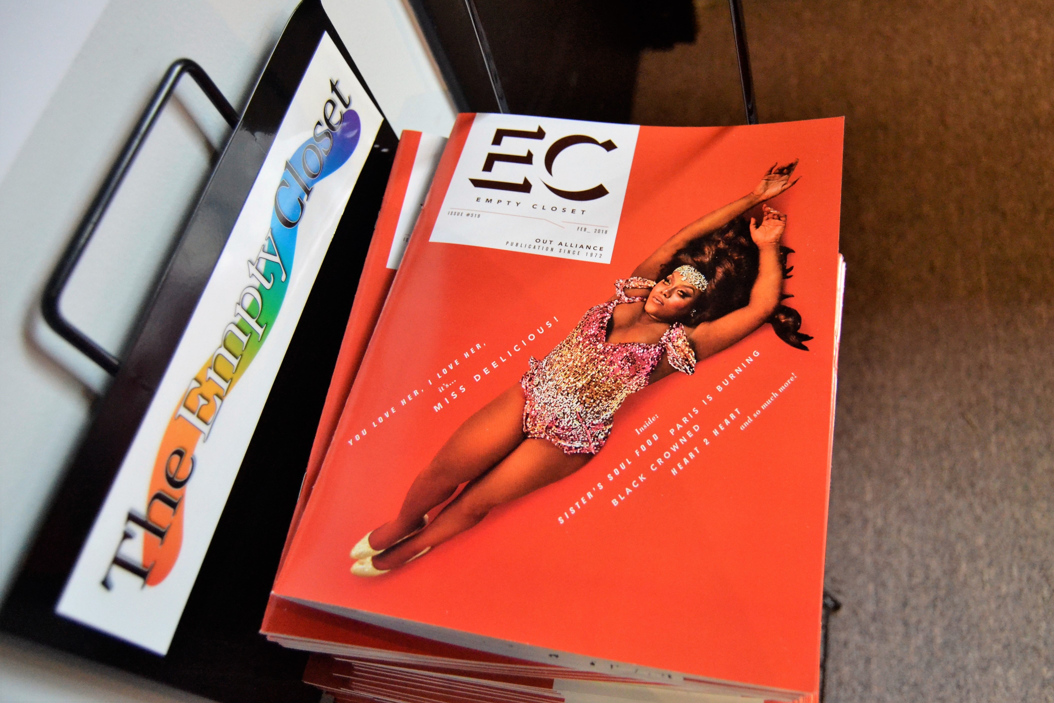 photo of a Empty Closet magazine rack with copies of Empty Closet in it