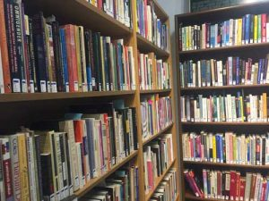 photo of bookshelves at the Out Alliance library