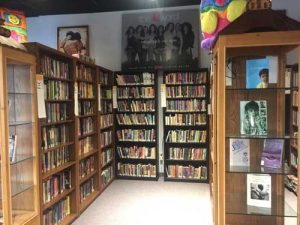 photo of bookshelves and books at the Out Alliance library