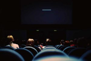 people in a theatre watching a movie, InQueery move night